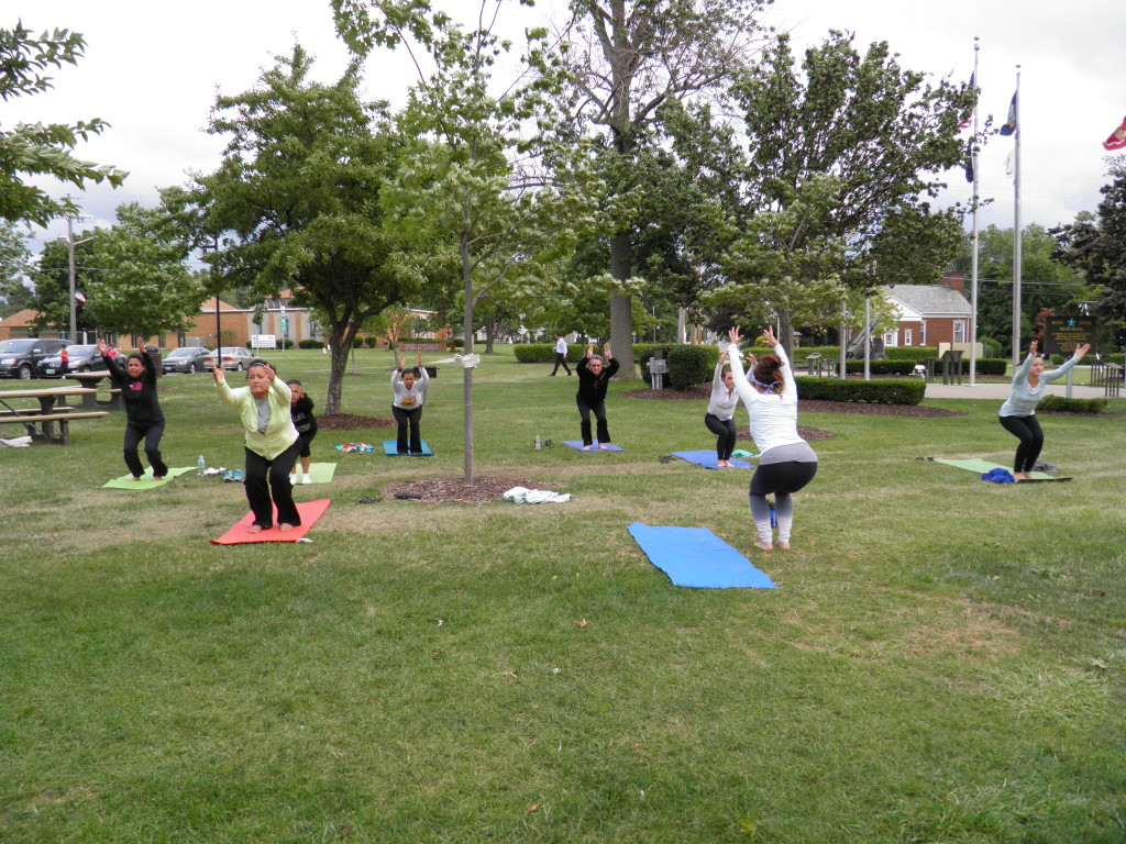 Yoga instructor , Julie VanMeter, instructs her class on the over ancient art of yoga