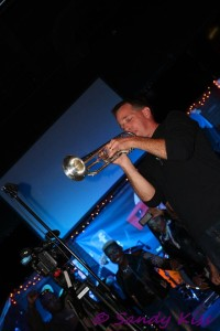 Todd Meany dueling on the Trumpet. Photo Credit : Sandy Kiss.